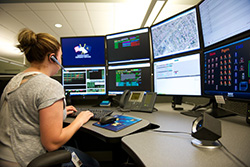911 Services | MCM Consulting Group | 911 Center Woman Operator Photo