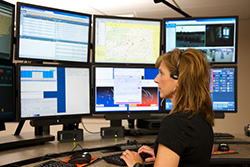 911 Services | MCM Consulting Group | 911 Next Generation System Center Woman Operator Photo